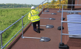 safety-rail-source-KeeGuard_PVC_man_walking_on_roof.jpg