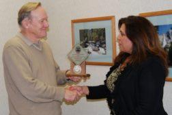 Sierra Monitor President Gordon Arnold presenting DLA award to Loree Calderon