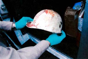 OSHA investigator documents the helmet of a fallen tower climber.