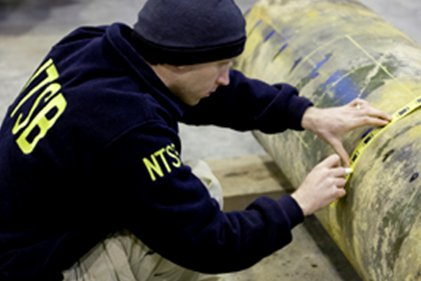 NTSB senior materials engineer Don Kramer identifies a section of pipe to be cut and removed for further examination at the NTSB's lab in Ashburn, Va.