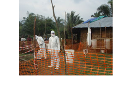MSF health staff in protective clothing constructing perimeter for Ebola isolation ward.