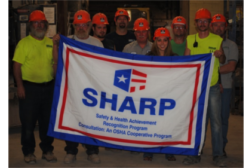 Taylor Taylor Concrete Products, Inc., celebrating their SHARP recognition with employees following a safety training session.